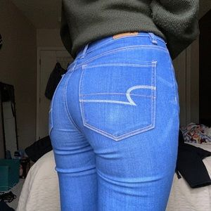 Bright blue high rise American Eagle skinny jeans